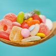 Spoon full of candy — Stock Photo