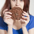 Young woman holding a cookie — Stock Photo