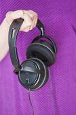 Woman holding headphones — Stock Photo