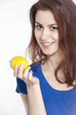 Young woman holding a lemon — Stock Photo