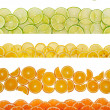 Slices of various citruses on white background — Stock Photo