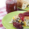 Rice pudding with raisins and dried apricots with strawberry jam — Stockfoto