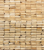 Background of a stack Of Wooden Boards From Ends — Stock Photo