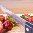 Stock Photo: Cutting Strawberries