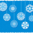 Stock Vector: Snowflake Christmas Ornaments on a Blue Background