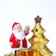 Golden xmas tree and santa claus — Stock Photo