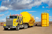 Yellow Transport With Oilfield Tanks — Photo