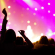 Crowd at a concert, audience raising hands up — Stock Photo