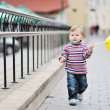 Adorable little boy with yellow baloon in heand — Stock Photo