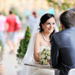 Bride and groom sitting together at an outdoor cafe — Stock Photo #10036062