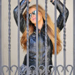 Stock Photo: Sexy girl behind bars
