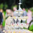 Lots of glasses champagne on table — Stock Photo #10037004