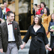 Happy bride and groom walking together — Stock Photo
