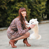 Cute puppie and happy young girl outdoors — Stock Photo