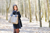 Portrait of young woman with shopping bag — Stock Photo