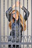 Sexy girl behind bars — Stock Photo