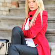 Stock Photo: Closeup, beauty shot of beautiful womin red coat