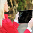 Stock Photo: Young womusing tablet pc