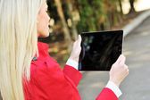 Young woman using tablet pc — Stock Photo