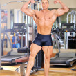 Royalty-Free Stock Photo: Bodybuilder posing at the gym