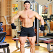 Bodybuilder posing at the gym — Stock Photo #10197124
