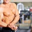 Muscular male torso of bodybuilder. Biceps — Stock Photo