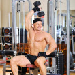 Stock Photo: Bodybuilder training in a gym
