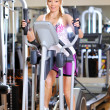 Stationary bicycles fitness girl in a gym sport club — Stock Photo