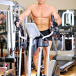 Stationary bicycles fitness man in a gym sport club — Stock Photo