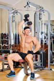 Bodybuilder training in a gym — Stock Photo