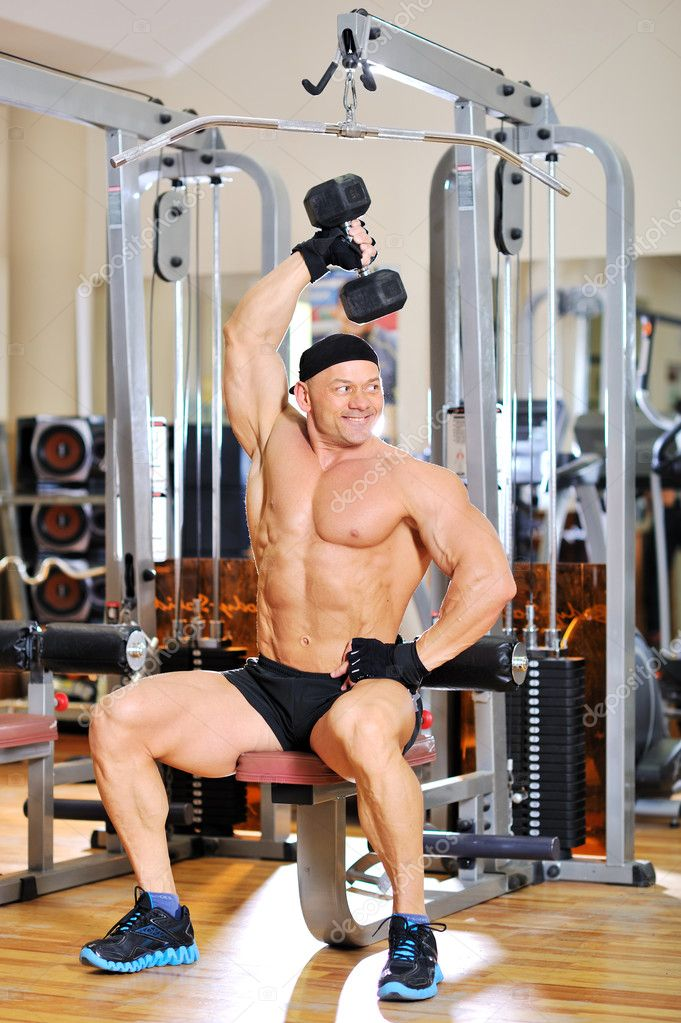 Bodybuilder training in a gym  Stock Photo #10197211