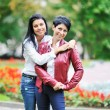Happy mother with her daughter in park outdoors — Stock Photo