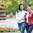Mother with daughter walking in autumn park — Stock Photo