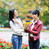 Adorable mother with her daughter in the park — Stock Photo