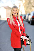 Pretty woman in red smiling and engaging — Stock Photo