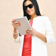 Pretty young woman using tablet pc — Stock Photo