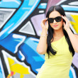 Beautiful female wearing sunglasses. — Stock Photo