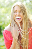 Closeup of beautiful young woman laughing enjoying summer days — Stock Photo