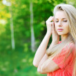 Portrait of a beautiful woman with eyes closed - Stock Photo