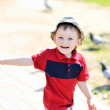 Adorable cute little baby boy smiling and having fun outdoors — Stock Photo