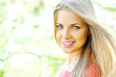 Closeup of happy cheerful smiling young beautiful blond woman, o — Stock Photo