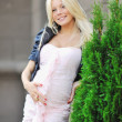 Pretty pregnant girl touching her tummy - Stock Photo