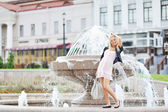 Beautiful young pregnant girl posing in the old town — Стоковое фото