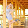 Young lady posing near the wooden structure - Stock Photo