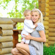 Portrait of young beautiful mother and her little boy - Outdoors — Stock Photo