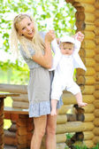Young beautiful mother playing with her little child — Stock Photo