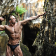 Stock Photo: Bodybuilder posing pulling the arm forward