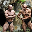 Stock Photo: Two successful bodybuilder posing