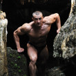 Muscular man climbs out of the cave — Stock Photo #10720588