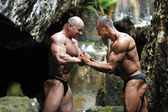 Two bodybuilders push each other — Stock Photo